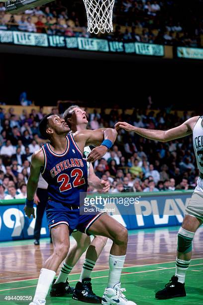 Larry Bird of the Boston Celtics shoots against Larry Nance of the Cleveland Cavaliers during a game in 1992 at the Boston Garden in Boston...