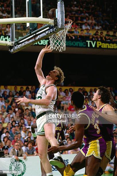 Larry Bird of the Boston Celtics shoots against Magic Johnson of the Los Angeles Lakers during the 1985 NBA Finals at the Boston Garden in Boston...