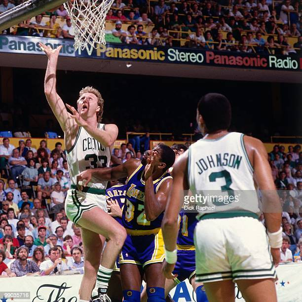 Larry Bird of the Boston Celtics shoots against Magic Johnson of the Los Angeles Lakers during the 1987 NBA Finals at the Boston Garden in Boston...