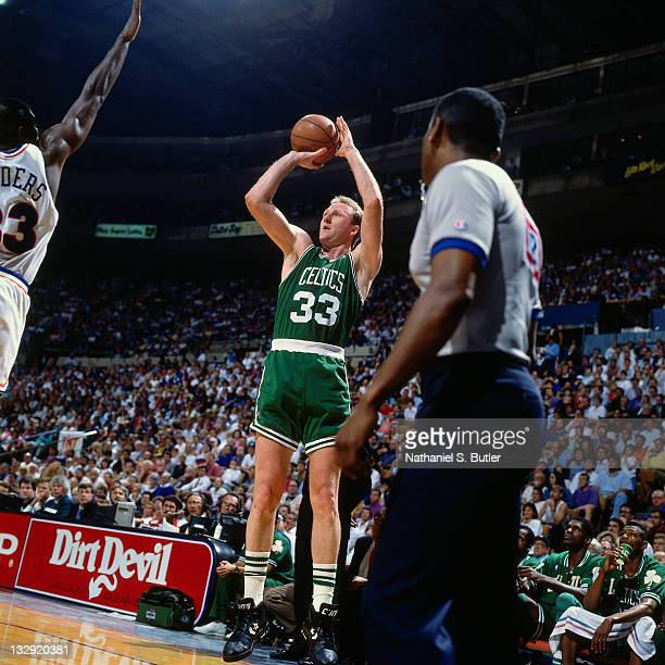Larry Bird of the Boston Celtics shoots against the Cleveland Cavaliers circa 1991 at the Richfield Coliseum in Richfield Ohio NOTE TO USER User...