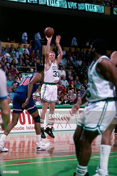 Larry Bird of the Boston Celtics shoots against the Cleveland Cavaliers during a game played in 1992 at the Boston Garden in Boston Massachusetts...
