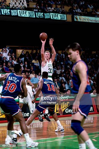 Larry Bird of the Boston Celtics shoots against the Cleveland Cavaliers during a game in 1992 at the Boston Garden in Boston Massachusetts NOTE TO...