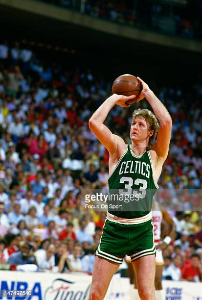 Larry Bird of the Boston Celtics shoots against the Houston Rockets during an NBA Finals June 1986 at The Summit in Houston, Texas. Bird played for...