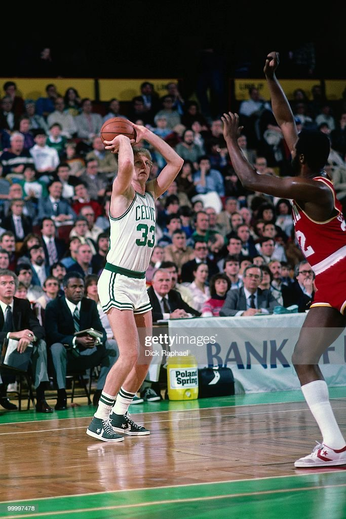 Larry Bird #33 of the Boston Celtics shoots against the Houston Rockets during a game played in 1983 at the Boston Garden in Boston, Massachusetts.