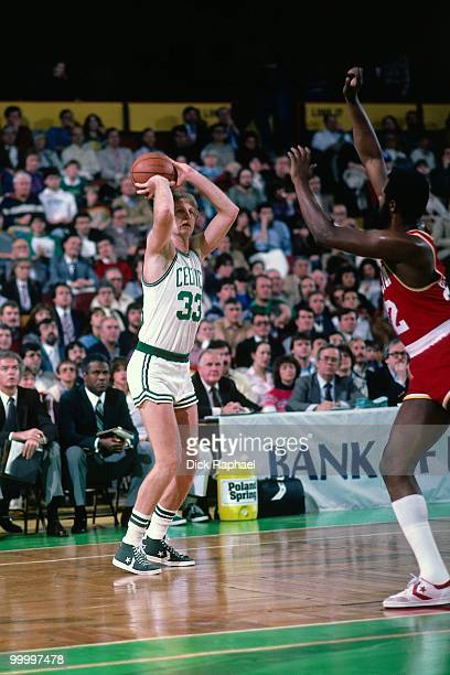 Larry Bird of the Boston Celtics shoots against the Houston Rockets during a game played in 1983 at the Boston Garden in Boston Massachusetts NOTE TO...