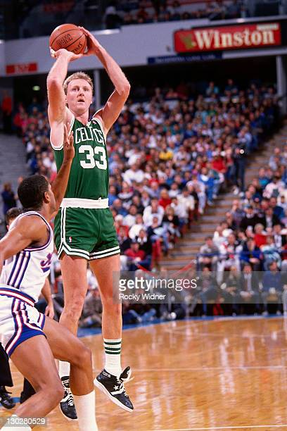 Larry Bird of the Boston Celtics shoots against the Sacramento Kings on December 27 1990 at Arco Arena in Sacramento California NOTE TO USER User...