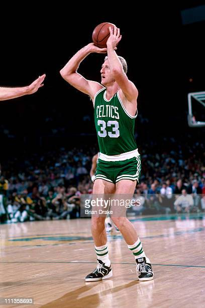Larry Bird of the Boston Celtics shoots against the Seattle Supersonics at the Seattle Coliseum in Seattle Washington circa 1988 NOTE TO USER User...
