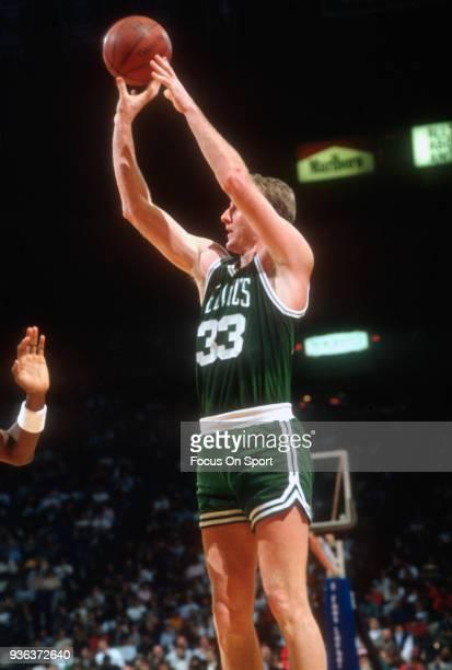 Larry Bird of the Boston Celtics shoots against the Washington Bullets during an NBA basketball game circa 1990 at the Capital Center in Landover...