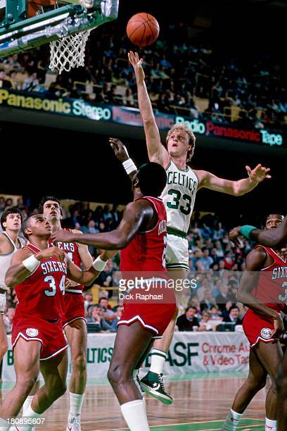 Larry Bird of the Boston Celtics shoots during a game against the Philadelphia 76ers circa 1984 at the Boston Garden in Boston Massachusetts NOTE TO...