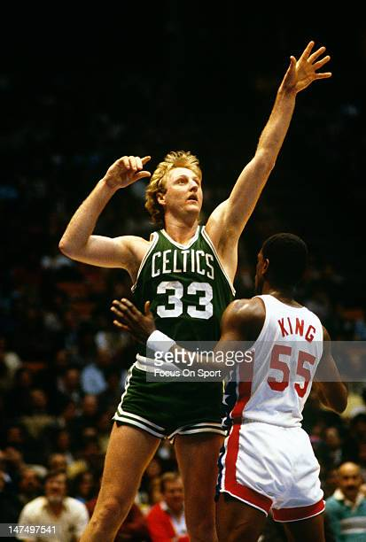 Larry Bird of the Boston Celtics shoots over Albert King of the New Jersey Nets during an NBA basketball game circa 1982 at the Brendan Byrne Arena...