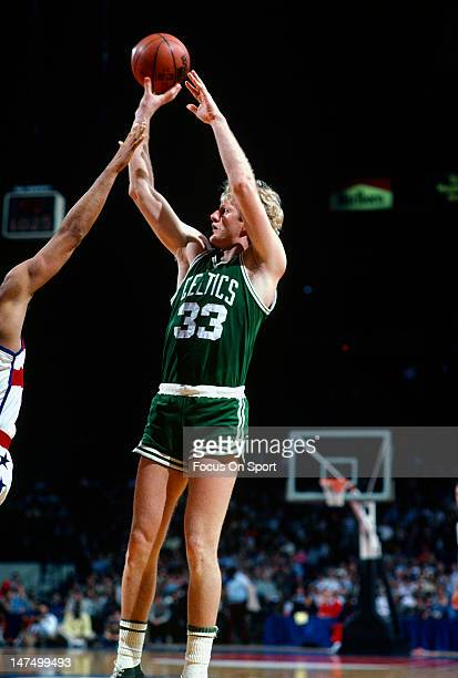 Larry Bird of the Boston Celtics shoots over Greg Ballard of the Washington Bullets during an NBA basketball game circa 1985 at the Capital Center in...