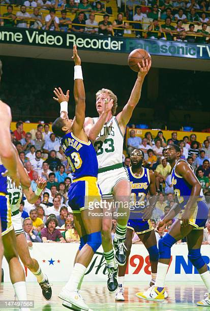 Larry Bird of the Boston Celtics shoots over Mychal Thompson of the Los Angeles Lakers during the NBA Finals June 1987 at The Boston Garden in Boston...