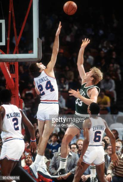 Larry Bird of the Boston Celtics shoots over the out stretched arm of Bobby Jones of the Philadelphia 76ers during an NBA basketball game circa 1984...