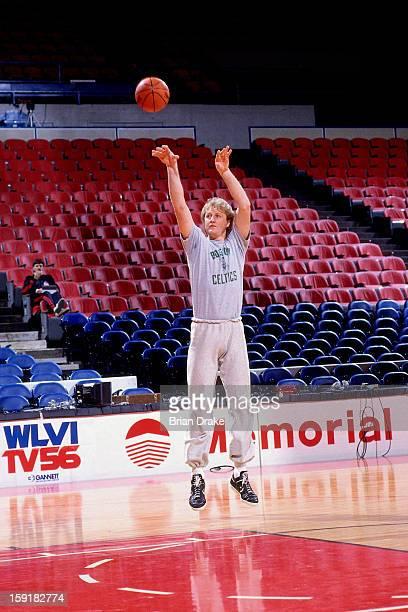 Larry Bird of the Boston Celtics shoots prior to a game against the Portland Trailblazers at the Veterans Memorial Coliseum in Portland Oregon circa...