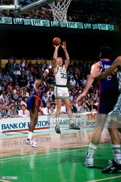Larry Bird of the Boston Celtics shoots shoots a jump shot against the Detroit Pistons circa 1991 at the Boston Garden in Boston Massachusetts NOTE...