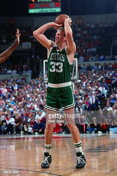 Larry Bird of the Boston Celtics shoots the ball against the Portland Trail Blazers during a game played at the Veterans Memorial Coliseum in...