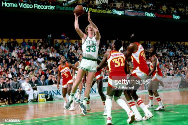 Larry Bird of the Boston Celtics shoots the ball during a game against the Atlanta Hawks circa 1984 at the Boston Garden in Boston Massachusetts NOTE...