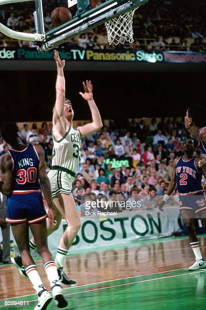 Larry Bird of the Boston Celtics shoots the floater against Bernard King of the New York Knicks during a game played in 1983 at the Boston Garden in...