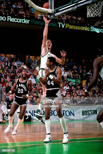 Larry Bird of the Boston Celtics shoots the floater over George Gervin of the San Antonio Spurs during a game played in 1984 at the Boston Garden in...