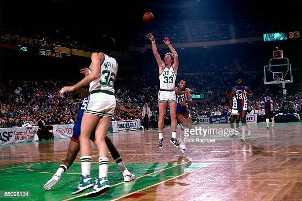 Larry Bird of the Boston Celtics shoots the jump shot against the New Jersey Nets during a game played in 1984 at the Boston Garden in Boston...