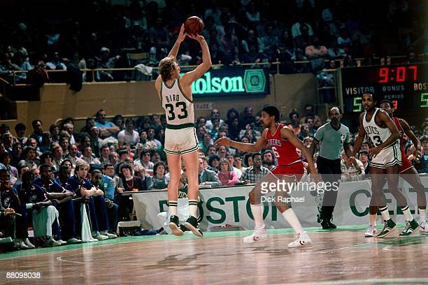 Larry Bird of the Boston Celtics shoots the jumper against Julius ' Dr J' Erving of the Philadelphia 76ers during a game played in 1984 at the Boston...