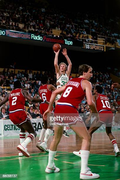 Larry Bird of the Boston Celtics shoots the jumper against Julius 'Dr J' Erving of the Philadelphia 76ers during a game played in 1984 at the Boston...