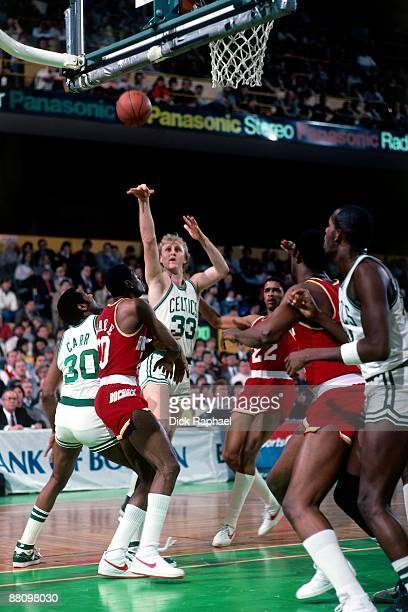 Larry Bird of the Boston Celtics shoots the pull up jumper against the Houston Rockets during a game played in 1984 at the Boston Garden in Boston...