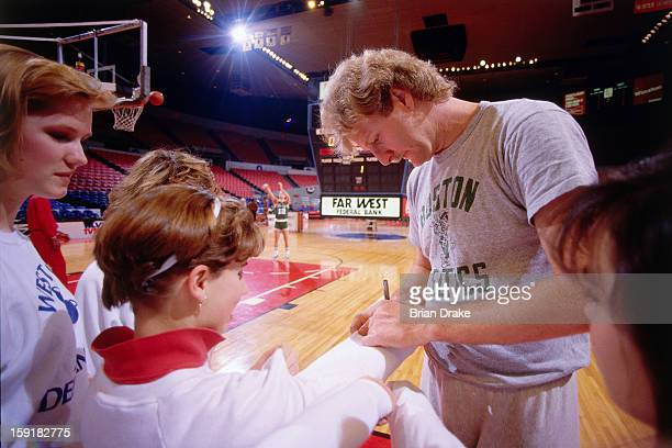 Larry Bird of the Boston Celtics signs autographs prior to a game against the Portland Trailblazers at the Veterans Memorial Coliseum in Portland...