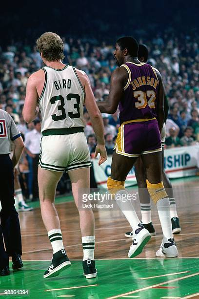 Larry Bird of the Boston Celtics stands against Magic Johnson of the Los Angeles Lakers during the 1985 NBA Finals at the Boston Garden in Boston...