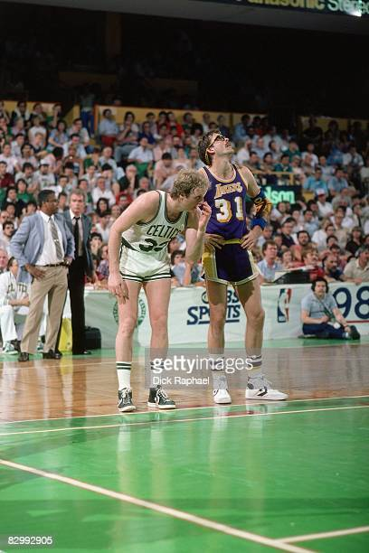 Larry Bird of the Boston Celtics stands next to Kurt Rambis of the Los Angeles Lakers in Game Five of the 1984 NBA Finals played on June 8 1984 at...