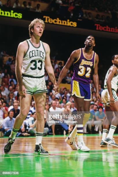 Larry Bird of the Boston Celtics stands next to Magic Johnson of the Los Angeles Lakers circa 1985 at the Boston Garden in Boston Massachusetts NOTE...