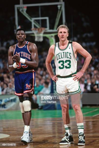 Larry Bird of the Boston Celtics stands on the court during a game against Patrick Ewing of the New York Knicks during a game played circa 1990 at...
