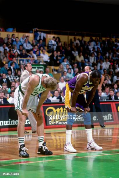 Larry Bird of the Boston Celtics stands on the court during a game against Magic Johnson of the Los Angeles Lakers during a game played in 1992 at...
