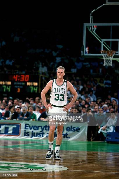 Larry Bird of the Boston Celtics stands on the court during a game circa 1990 at the Boston Garden in Boston Massachusetts NOTE TO USER User...