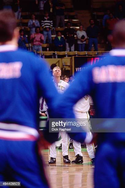 Larry Bird of the Boston Celtics stands on the court for the National Anthem before a game against the Cleveland Cavaliers circa 1992 at the Boston...