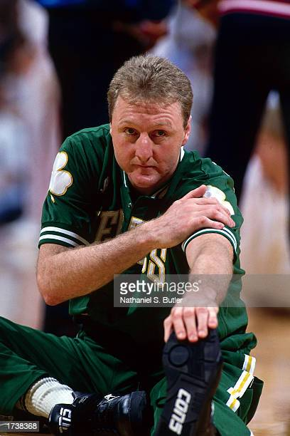 Larry Bird of the Boston Celtics stretches before playing an NBA game at the Boston Garden on January 1 1991 in Boston Massachusetts NOTE TO USER...