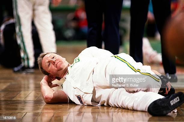 Larry Bird of the Boston Celtics stretches prior to playing a 1991 NBA game at the Boston Garden in Boston Massachusetts NOTE TO USER User expressly...