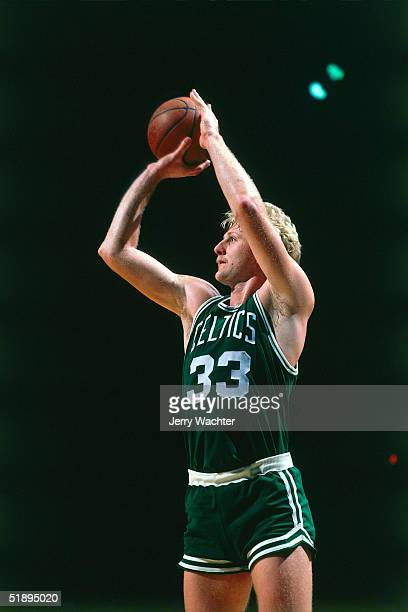 Larry Bird of the Boston Celtics takes a jumper during an NBA game. NOTE TO USER: User expressly acknowledges and agrees that, by downloading and or...