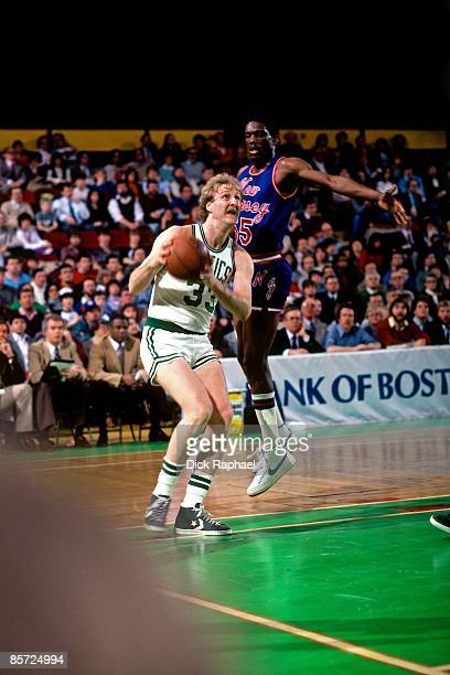 Larry Bird of the Boston Celtics takes the ball to the basket against Albert King of the New Jersey Nets during a game played in 1982 at the Boston...