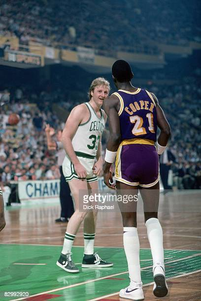 Larry Bird of the Boston Celtics talks with Michael Cooper of the Los Angeles Lakers in Game Five of the 1984 NBA Finals played on June 8 1984 at...