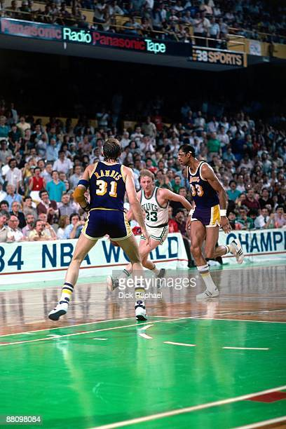 Larry Bird of the Boston Celtics weaves through traffic against Kareem AbdulJabbar and Kurt Rambis of the Los Angeles Lakers during a game played in...