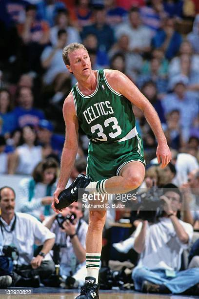 Larry Bird of the Boston Celtics wipes his sneakers at the Boston Garden in Boston Massachusetts circa 1991 NOTE TO USER User expressly acknowledges...
