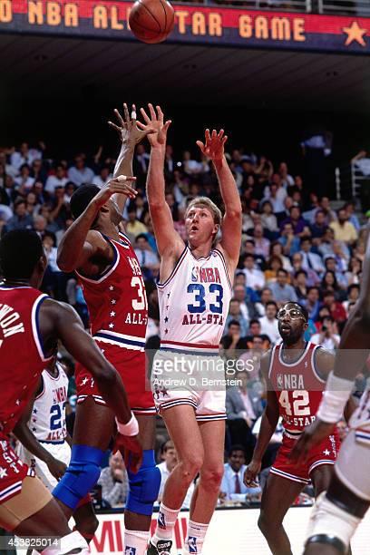 MIAMI FEBRUARY 11 Larry Bird of the East AllStars shoots against Magic Johnson of the West AllStars during the 1990 NBA AllStar Game on February 11...