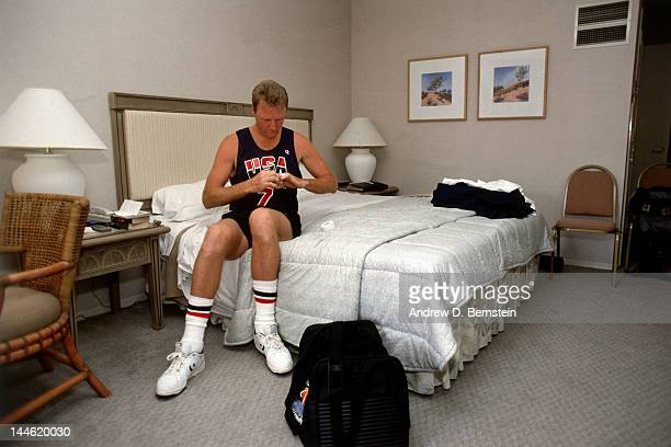 Larry Bird of the United States National Team sits in his hotel room prior to practice in June 1992 in La Jolla California NOTE TO USER User...