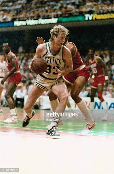 Larry Bird pivots past Rocket's Rodney McCray during third quarter action of game two of the NBA Championship at Boston Garden, 5/29. Bird scored 31...