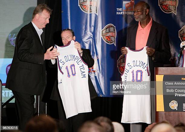 Larry Bird receives a jersey from John L Doleva President and CEO of the Naismith Memorial Hall of Fame in honor of the 1992 USA Olympic Basketball...