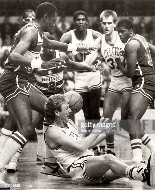 Larry Bird scrambles for a loose ball against the Bullets April 1 1987 at Boston Garden