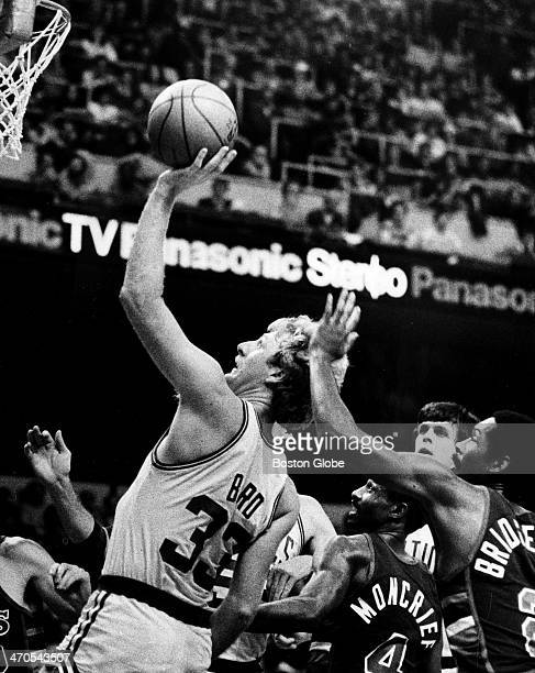 Larry Bird shoots and gets two points in front of the Bucks' Junior Bridgeman as the Milwaukee Bucks play the Boston Celtics at Boston Garden on Nov...