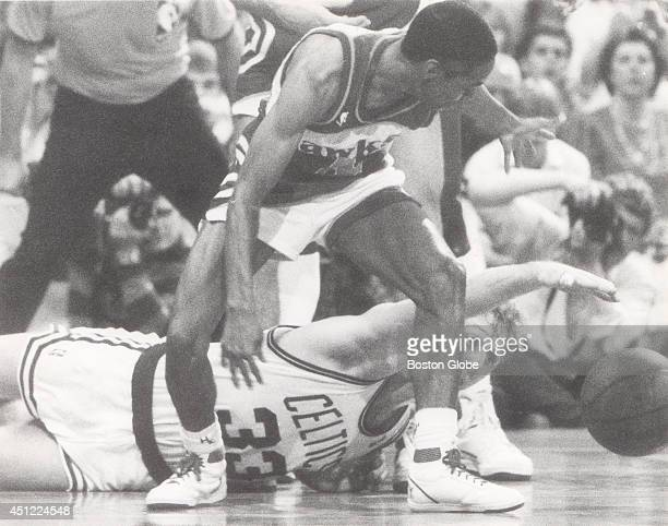 Larry Bird steals the ball away from Atlanta Hawks Spud Webb Photo by Paul Benoit/The Boston Globe via Getty Images