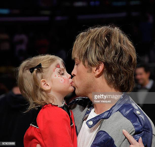 Larry Birkhead and his daughter Dannielynn Birkhead kiss at a game between the New Orleans Hornets and the Los Angeles Lakers at Staples Center on...